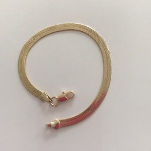 Jewelry - This is a gold plated bracelet. 7 inches long